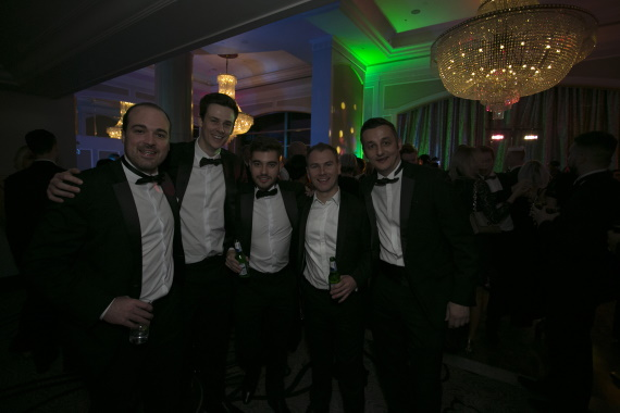 Gareth Broom, Oliver Wales, Daniel Moore and Oliver Wales with a client at The Negotiator Awards 2017